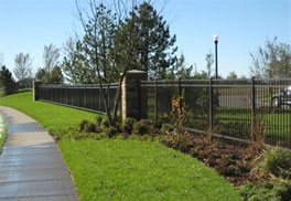 Decorative steel and aluminum fences define boundaries without walls.