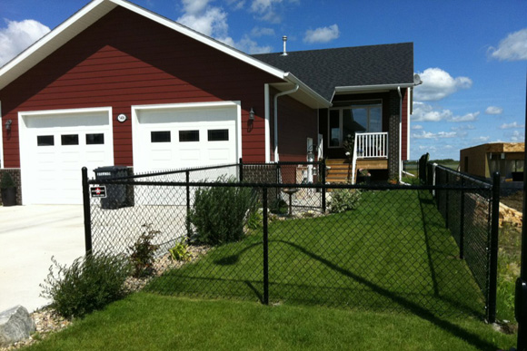 Lloydminster house with chain-link fence
